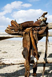 Saddle on rural fence Royalty Free Stock Photography