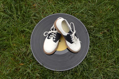 Saddle shoes and record Royalty Free Stock Image