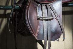 Saddle in the stable. Brown sddle in the stable stock photo