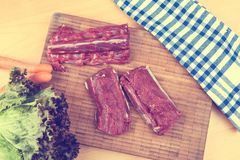 Saddle of venison on wooden board Royalty Free Stock Image