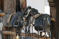Saddles. Horse farm equipment, saddles and stirrups Stock Images