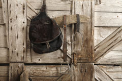 Saddles. And bridles in the stable Royalty Free Stock Photo