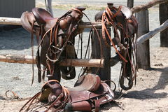 Saddles. Setting on a fence Royalty Free Stock Photos