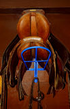 Saddles. Two saddles on a rack in a tack room, horseback riding equipment Royalty Free Stock Photos