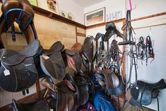 Saddles for sale. Saddles displayed in a old shop,in Mortonhampstead. Mortonhampstead is an old market town on Dartmoor in the middle of the county of Devon stock photos