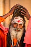 Sadhu or Baba  on the ghats of Ganges river. Stock Photography