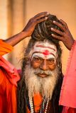 Sadhu or Baba holy man on the ghats of Ganges river. Stock Photos