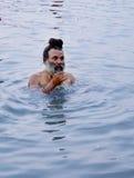 A sadhu bathing in river kshipra, simhasth maha kumbh mela 2016, Ujjain India Stock Images