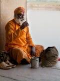 Sadhu chanting on beads Royalty Free Stock Images