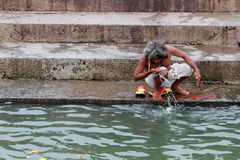 Sadhu do rituals in the river  at Kumbha Mela Stock Photography