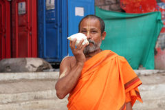 Sadhu holds a white conch Royalty Free Stock Photography