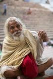 Sadhu holy man on Dashashwamedh Ghat is the main and probably oldest ghat of Varanasi Royalty Free Stock Photo