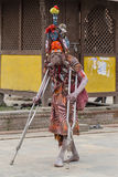 Sadhu, holy man patient on crutches in Pashupatinath Temple, Kathmandu. Nepal. KATHMANDU, NEPAL - SEPTEMBER 29, 2016 : Sadhu, holy man patient on crutches in Stock Photography