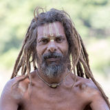 Sadhu, holy man sits on the ghat along the Ganges river. Rishikesh, India Royalty Free Stock Photography
