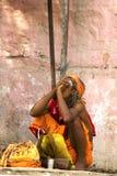 Sadhu (holy man) smokes a pipe Royalty Free Stock Photos