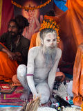 Sadhu at Kumbh Mela Festival in Allahabad, India. Naked sadhu (Indian holy man) giving blessings at Kumbh Mela, the world's largest religious festival, in Royalty Free Stock Photography