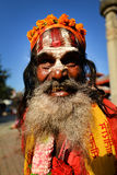 Sadhu man seeking alms in Durbar square. Kathmandu, Nepal Royalty Free Stock Images