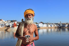 Sadhu man stands at the banks of Pushkar lake. An unidentified sadhu man stands at the banks of Pushkar lake on February 05,2015 in Pushkar, Rajasthan, India Royalty Free Stock Photo