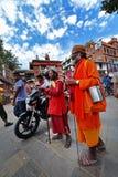 Sadhu men seeking alms in Durbar square. Kathmandu, Nepal Royalty Free Stock Photo