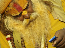 Sadhu with mobile phone in Shivaratri Royalty Free Stock Photography