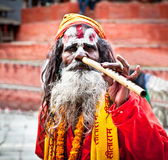 Sadhu play flute at Pashupatinath Temple in Kathmandu, Nepal. Royalty Free Stock Image