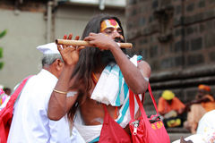 Sadhu plays flute Royalty Free Stock Photography