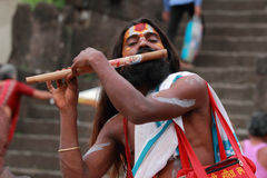 Sadhu plays flute Stock Photos