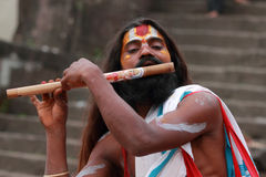 Sadhu plays flute Royalty Free Stock Photography
