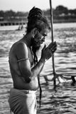 A Sadhu in prayer in river Ganga in Allahabad, India Royalty Free Stock Photo