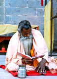 A sadhu reading religious script on the bank of kshipra river in great kumbh mela 2016, Ujjain, India Royalty Free Stock Images