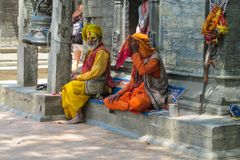 Sadhu religious ascetic mendicant men. Sadhu, saddhu religious ascetic mendicant monk holy person in Hinduism and Jainism sitting in a temple in Nepal Royalty Free Stock Image