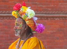 Sadhu religious ascetic mendicant men. Sadhu, saddhu religious ascetic mendicant monk holy person in Hinduism and Jainism sitting in a temple in Nepal Royalty Free Stock Photos