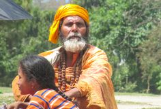 Sadhu religious ascetic menin Nepal. Sadhu, saddhu religious ascetic mendicant monk holy person in Hinduism and Jainism sitting in a temple in Nepal Stock Photography