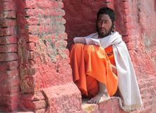 Sadhu religious ascetic mendicant man. Sadhu, saddhu religious ascetic mendicant monk holy person in Hinduism and Jainism sitting in a temple in Nepal Royalty Free Stock Photo
