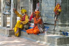 Sadhu religious ascetic men in Nepal. Sadhu, saddhu religious ascetic mendicant monk holy person in Hinduism and Jainism sitting in a temple in Nepal Royalty Free Stock Images