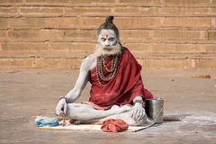 Sadhu sits on the ghat along the Ganges river in Varanasi, India. Stock Photography