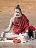 Sadhu sits on the ghat along the Ganges river in Varanasi, India. Royalty Free Stock Images