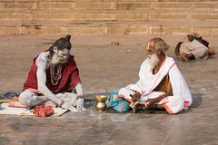 Sadhu sits on the ghat along the Ganges river in Varanasi, India. Royalty Free Stock Photo