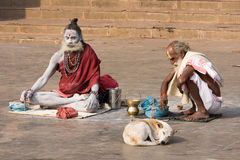 Sadhu sits on the ghat along the Ganges river in Varanasi, India. Stock Images