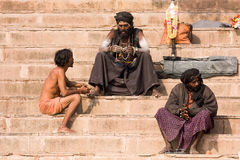 Sadhu sits on the ghat along the Ganges river in Varanasi, India. Stock Image