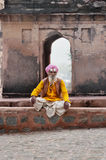 Sadhu sitting near Temple on the street in Orchha Royalty Free Stock Photos