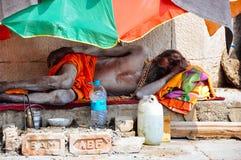 A sadhu sleeps in Varanasi, India. A sadhu sleeps in the shade in Varanasi, India royalty free stock photography