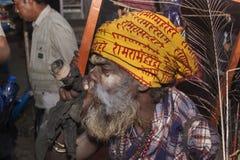 Sadhu smokes a pipe. Stock Photos