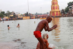 Sadhu takes bath in river Godavari at kumbhamela Royalty Free Stock Images