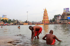 Sadhu takes bath in river Godavari at kumbhamela Stock Photos