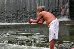 Sadhu takes bath in the river Godavari Royalty Free Stock Photo