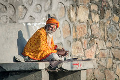 Sadhu with traditional painted face , Nepal Royalty Free Stock Images