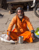 Sadhu in Varanasi. A sadhu with leprosy is sitting in the holy city of Varanasi Royalty Free Stock Image