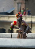 Sadhu walking on the bridge Royalty Free Stock Photo