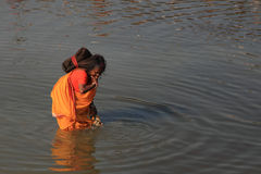 A Sadhu woman gets refreshed in the river water at Kumbh Mela. On February 08, 2013 in Allahabad, India. Kumbh Mela is considered as the largest human gathering Royalty Free Stock Photo